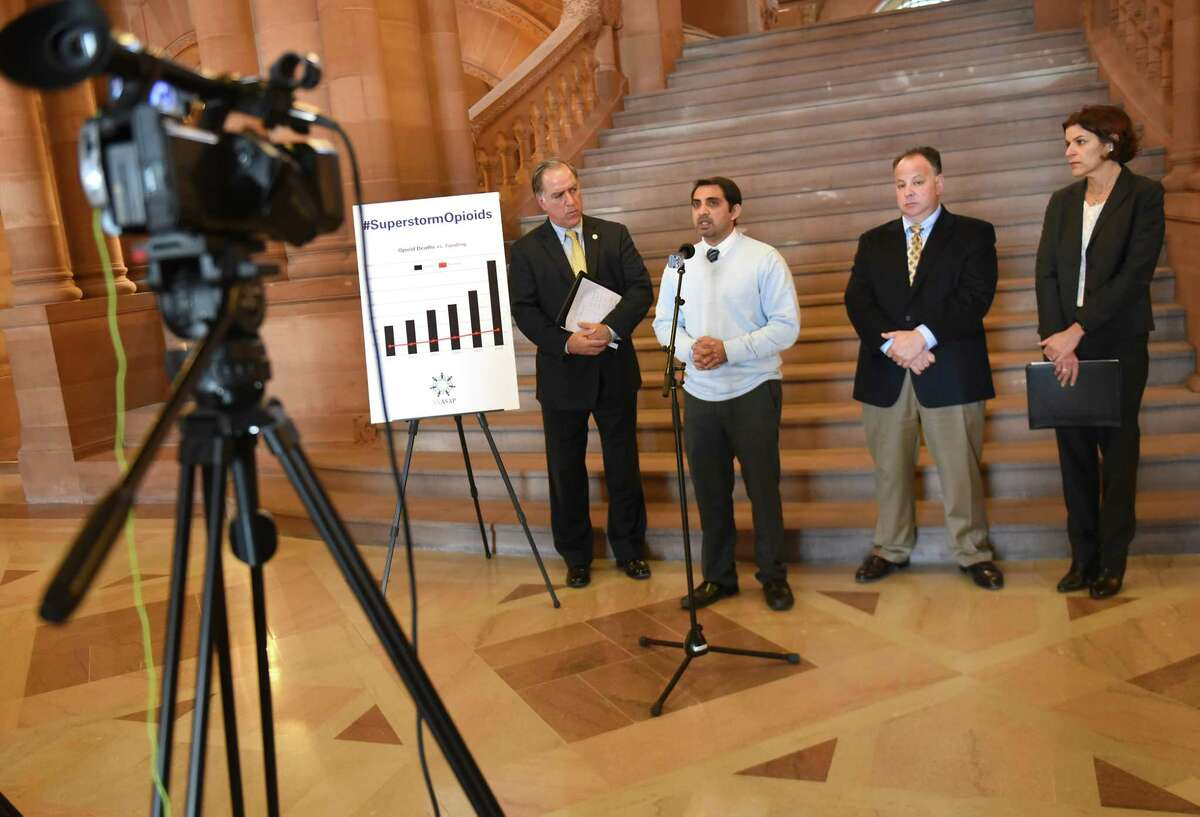 """Cardiologist Mustafain Meghani, second from left, speaks during a press conference to announce the launching of the ?""""Superstorm Opioids?• advocacy campaign in the New York State Capitol on Tuesday, Dec. 19, 2017 in Albany, N.Y. Also with him from left are, New York Association of Alcoholism And Substance Abuse Providers (ASAP) Executive Director John Coppola, Kevin Connally, executive director of Hope House, and Stephanie Campbell, executive director of Friends of Recovery New York. (Lori Van Buren / Times Union)"""