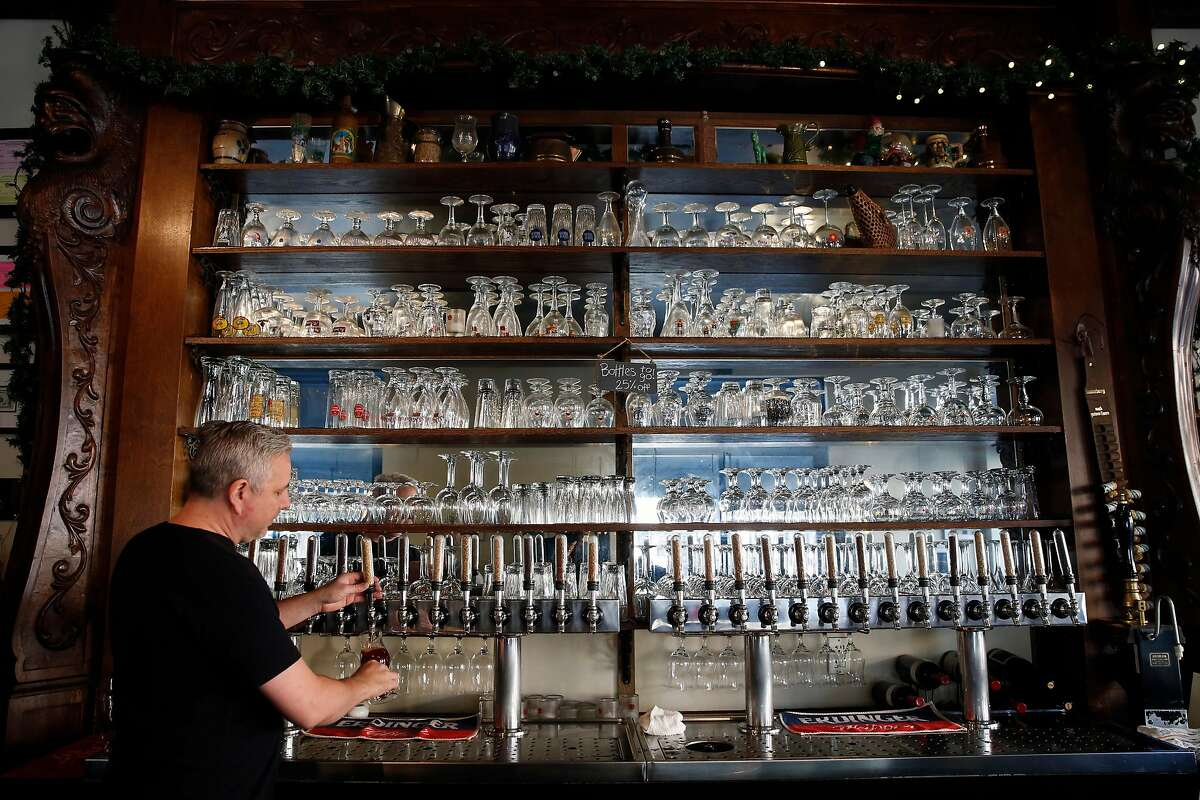 Bob DeMoisey pours a beer at Monk's Kettle restaurant and bar in the Mission neighborhood on Monday December 18, 2017, in San Francisco, Ca.