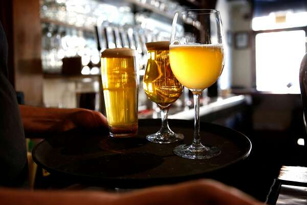 Glasses of beer are served at Monk's Kettle restaurant and bar in the Mission neighborhood on Monday December 18, 2017, in San Francisco, Ca.