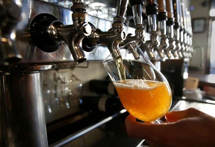Craft beer is poured at Monk's Kettle restaurant and bar in the Mission neighborhood on Monday December 18, 2017, in San Francisco, Ca.