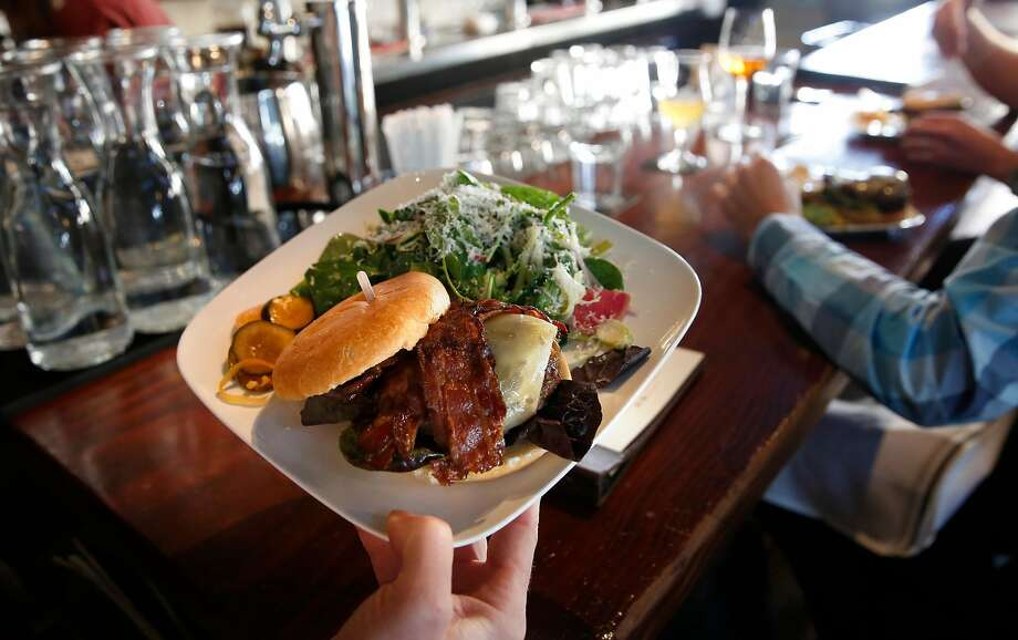 A bacon burger is served up at Monk's Kettle restaurant and bar in the Mission neighborhood. Photo: Michael Macor, The Chronicle