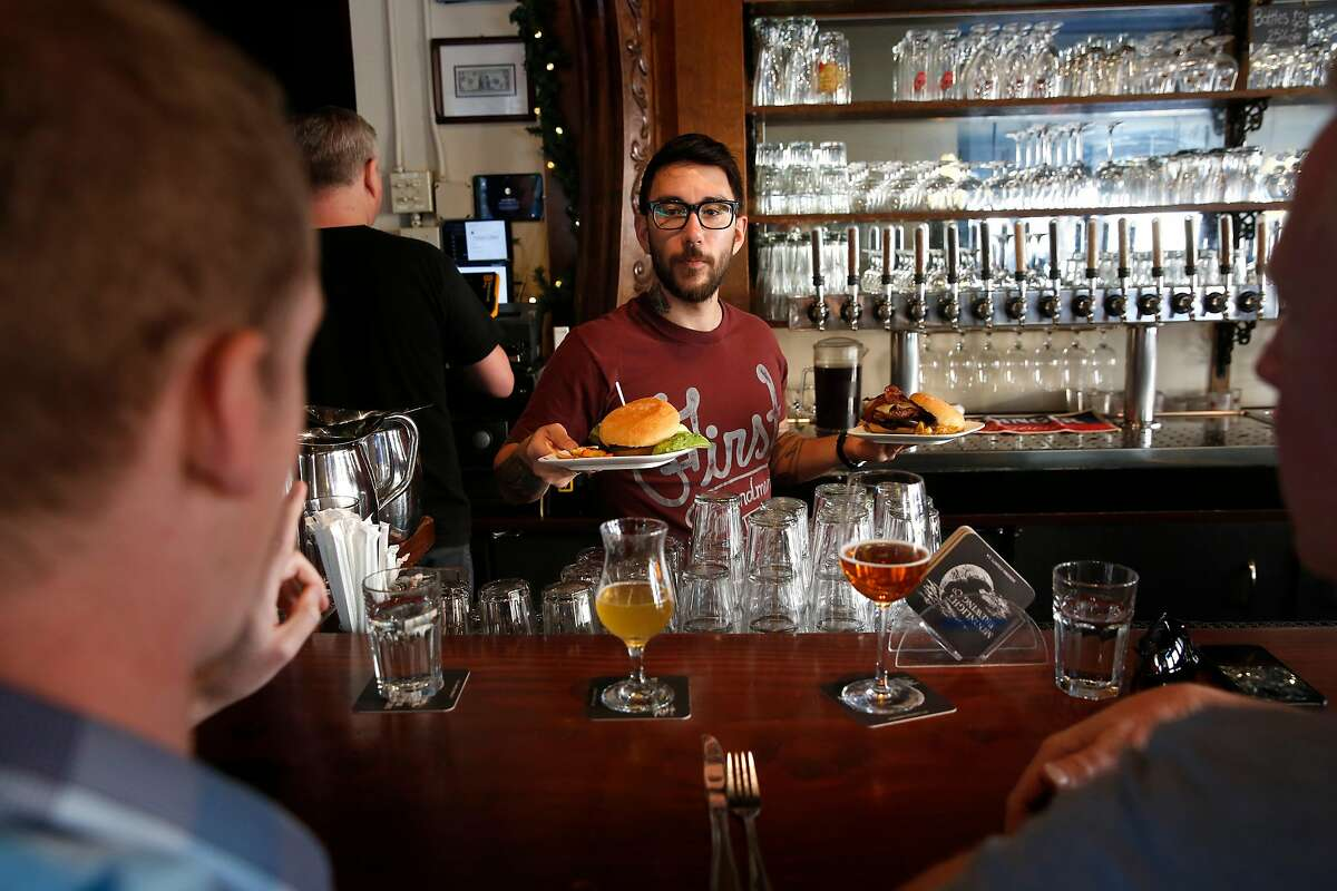 Bryce Bishari serves patrons lunch at Monk's Kettle restaurant and bar in the Mission neighborhood on Monday December 18, 2017, in San Francisco, Ca.