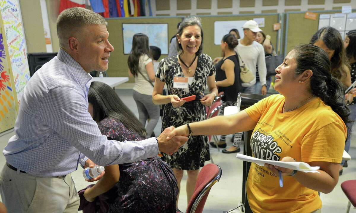 Westhill High School's new principal Michael Rinaldi talks with Maria Zapata following a Meet and Greet at Building One Community on Tuesday, August 22, 2017 in Stamford, Connecticut. Zapata, who's teenage daughter will be entering the ninth grade, had a chance to meet with Rinaldi and several questions about the school and what they should expect for their children.