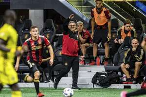 Atlanta United Head Coach Gerardo Martino directs the team during the second period of extra time of an MLS playoff soccer game against Columbus Crew, in Atlanta, Thursday, Oct. 26, 2017. The Columbus Crew won in a 3-1 shootout. (AP Photo/Danny Karnik)