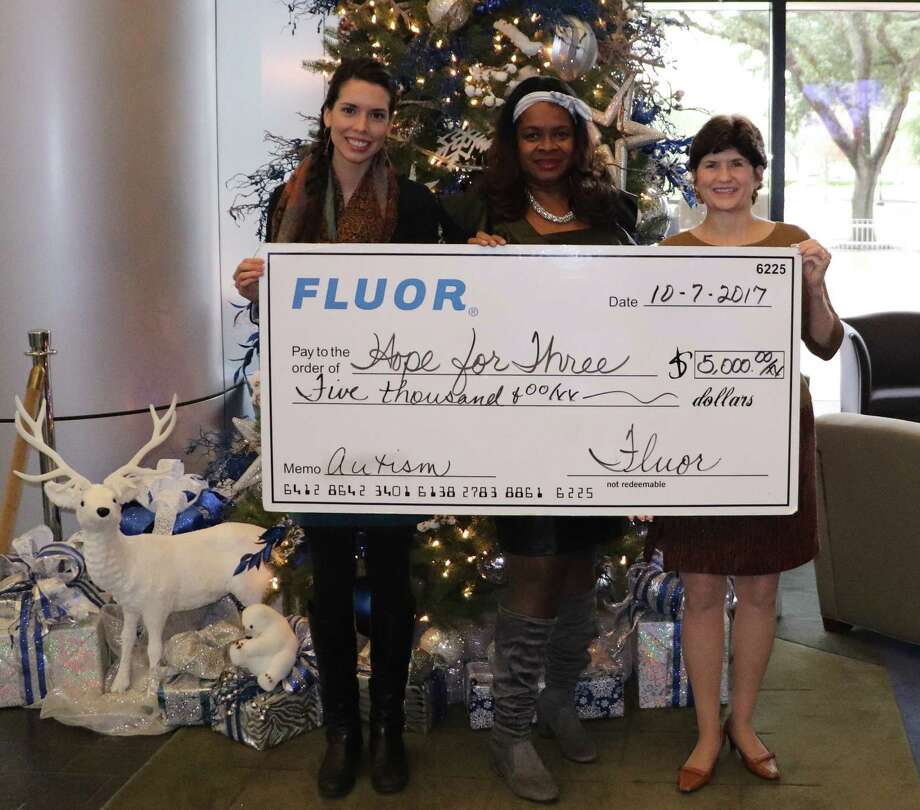 Pictured from left are Elizabeth Munoa, Hope For Three Family Assistance Coordinator; Barbara Jones, Fluor Senior Manager, Community and Public Affairs; and Darla Farmer, Hope For Three, Executive Director and Founder, as they celebrate this holiday season with the greatest gift of all, a gift of hope. Photo: Courtesy Photo