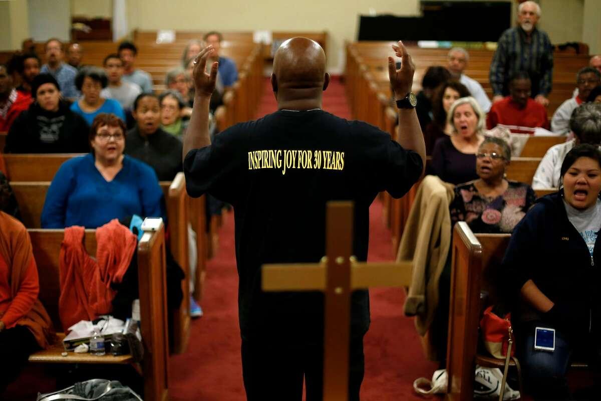 Terrance Kelly leads an Oakland Interfaith Gospel Choir practice at the Imani Community Church in Oakland, California, on Monday, Nov. 2, 2015.
