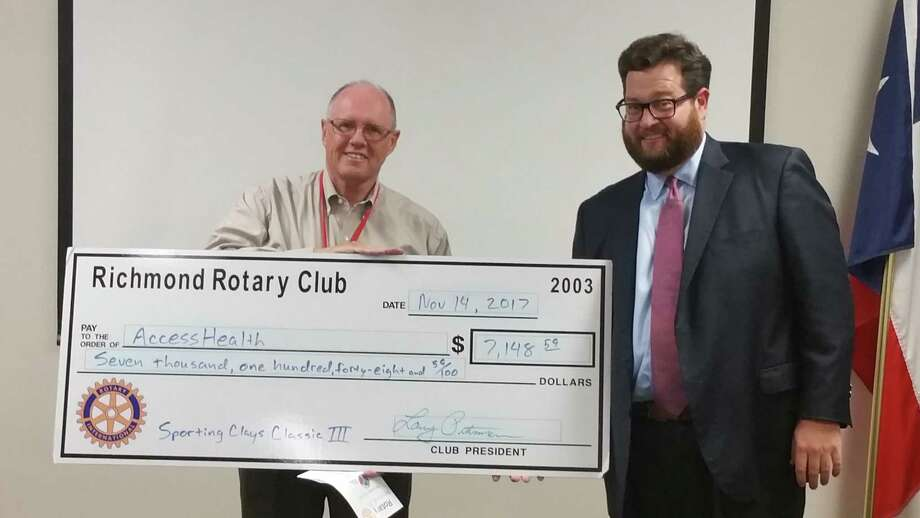 Using funds raised from from the Rotary Club of Richmond's Sporting Clays Classic III, Rotary Club President Larry Pittman presented a donation recently to Access Health CEO Mike Dotson. Photo: Rotary Club Of Richmond