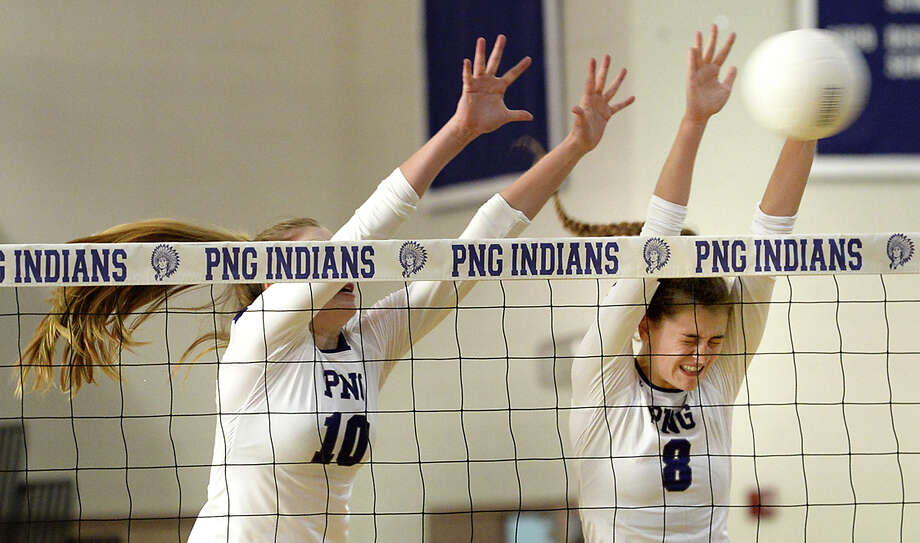 Port Neches - Groves' Elizabeth Bolyard (left) and Kaitlyn Gil team up to block the shot by West Brook during their non-district match-up Tuesday in Port Neches. Photo taken Tuesday, August 15, 2017 Kim Brent/The Enterprise Photo: Kim Brent / BEN