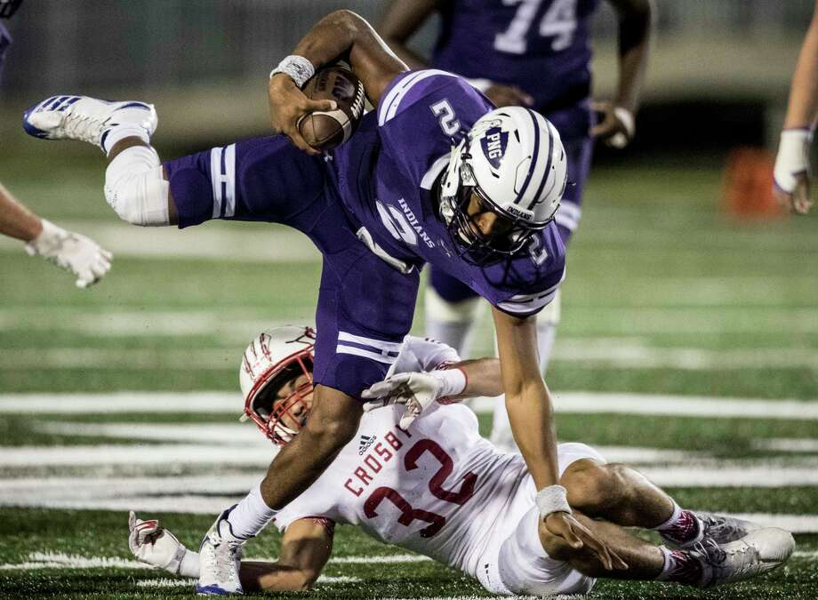 Port Neches-Groves quarterback Roschon Johnson 92) is tripped up by Crosby defender Hunter Bradford (32) during the first quarter of a Class 5A bi-district playoff football game at Stallworth Stadium on Friday, Nov. 17, 2017, in Baytown. ( Brett Coomer / Houston Chronicle ) Photo: Brett Coomer, Staff / © 2017 Houston Chronicle