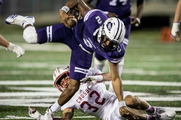 Port Neches-Groves quarterback Roschon Johnson 92) is tripped up by Crosby defender Hunter Bradford (32) during the first quarter of a Class 5A bi-district playoff football game at Stallworth Stadium on Friday, Nov. 17, 2017, in Baytown. ( Brett Coomer / Houston Chronicle )