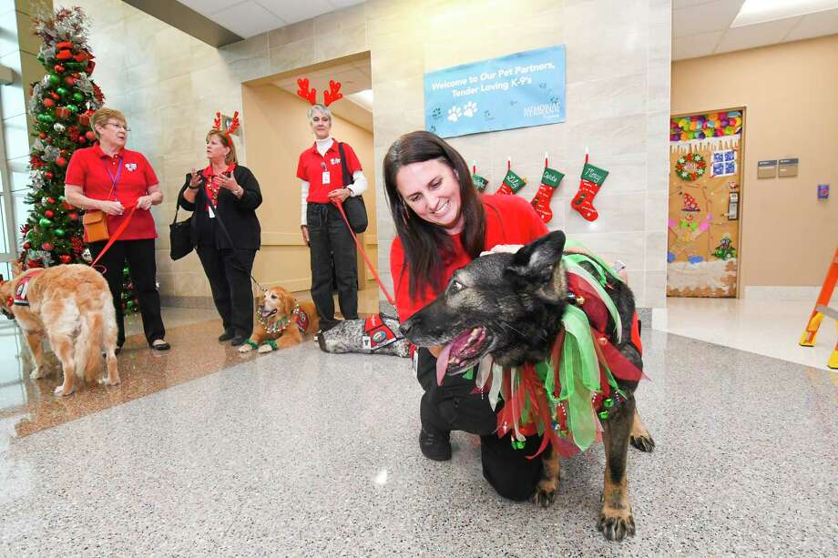 Shannon Smith and her dog Bonny are ready  to visit patients at Memorial Herman  Cypress Hospital. Dogs are offering a special type of medicine to patients at Memorial Hermann Cypress Hospital as the facility joins a roster of surrounding area centers that includes a pet therapy program on site. Photo: Tony Gaines/ HCN, Photographer