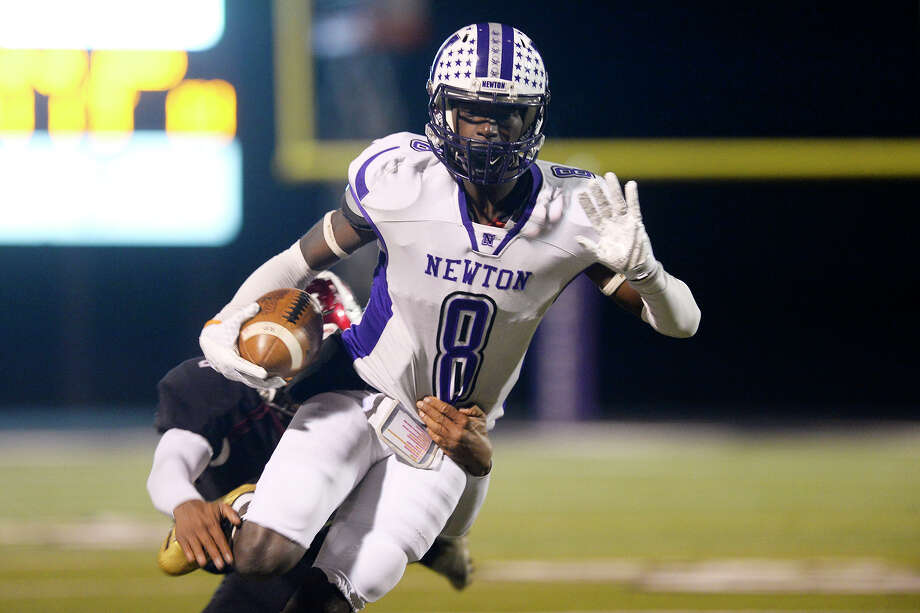 Newton's Tamauzia Brown is tackled by a Waskom player in the Class 3A Division II regional final at Abe Martin Stadium in Lufkin on Friday night.  Photo taken Friday 12/8/17 Ryan Pelham/The Enterprise Photo: Ryan Pelham / ©2017 The Beaumont Enterprise/Ryan Pelham