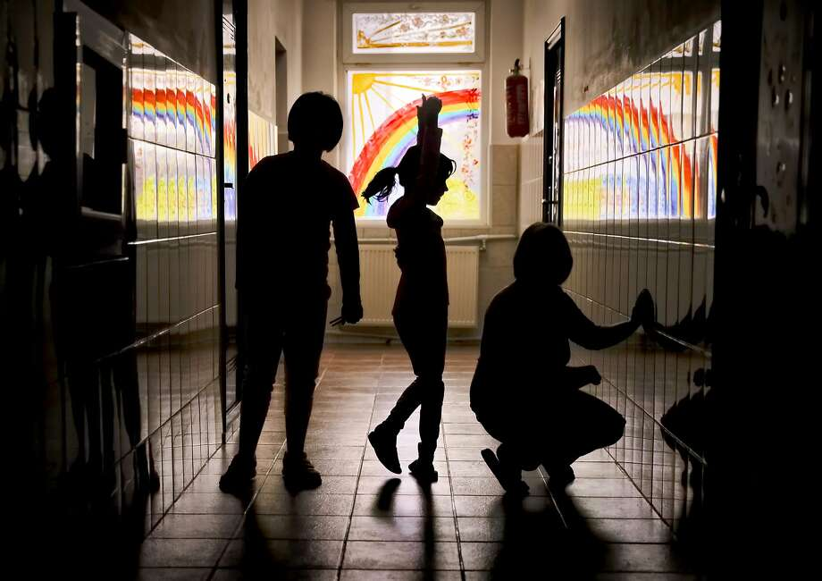 Sara, a child living at the Robin Hood orphanage, tries a ballet move with other children in Bucharest, Romania. One of the old-style orphanages still operating in Bucharest, it is due to close in 2018. Photo: Vadim Ghirda, Associated Press