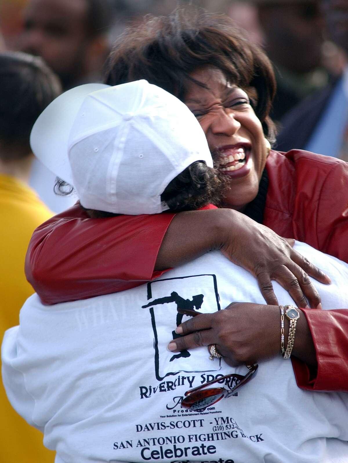 East San Antonio area state Rep. Ruth Jones McClendon hugs parade marshal Paulette Burns before the 2017 MLK march.