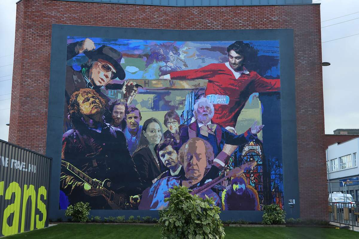 The East Belfast heroes mural on the side of the local visitors center.