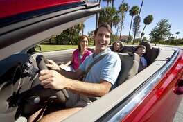 Family Driving In Convertible Car (Dreamstime/TNS)