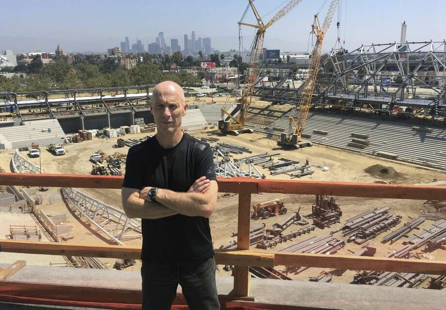 LAFC (Los Angeles Football Club) coach Bob Bradley poses in front of the Los Angeles skyline from the roof of the team's new Banc of California Stadium on Friday, July 28, 2017. The MLS expansion club hired Bradley as its first coach. (AP Photo/Greg Beacham) Photo: Greg Beacham/AP