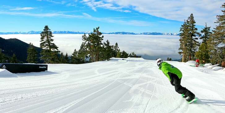 Eric Kertzman snowboards with a full front view of Lake Tahoe covered with a bowl-like phenomenon of fog as sails down the Crystal Ridge at Diamond Peak Ski Area near Incline on the Nevada side of Tahoe.