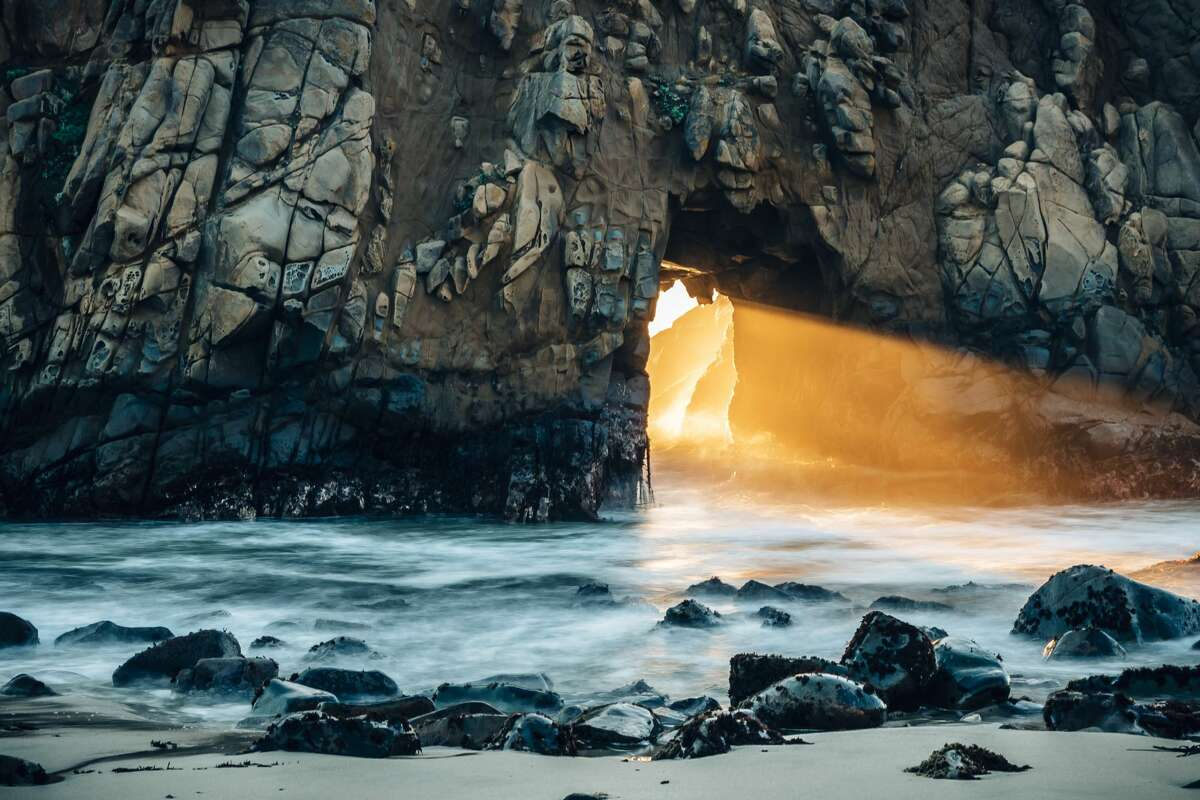 For just a few weeks mid-winter, Keyhole Arch at Pfeiffer Beach in Big Sur, Calif. lights up with an ethereal orange glow. Courtesy: Yusun Chung/@edwoodya