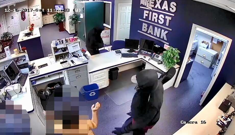 Police in La Marque are searching for two armed suspects who robbed the Texas First Bank, 407 Oak Street, on Saturday, Dec. 16, 2017. The suspects got away with $188,000. Photo: La Marque Police Department