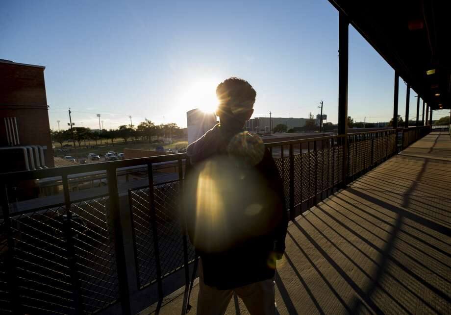 Seventeen-year-old Jose leaves school heading to a spot where his mother will pick him up. Jose, a Deferred Action for Childhood Arrivals program recipient, worries about being forced to leave the U.S. Photo: Godofredo A. Vasquez/Houston Chronicle