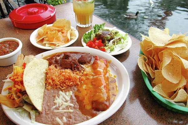 The Deluxe Dinner at Casa Rio includes a cheese enchilada, a tamal, a crispy taco, chile con carne, rice, beans, queso and a guacamole salad. Jalapeño margarita and duck not included.