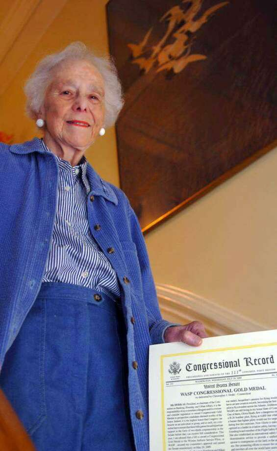 Gloria Heath, holding the Congressional proclamation she received in 2010 Photo: / Helen Neafsey