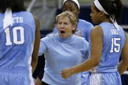 North Carolina head coach Sylvia Hatchell, center, talks with Danielle Butts and Allisha Gray during a timeout in the second half of an NCAA college basketball game against Pittsburgh on Thursday, Jan. 8, 2015, in Pittsburgh. Pittsburgh upset North Carolina 84-59. (AP Photo/Keith Srakocic)