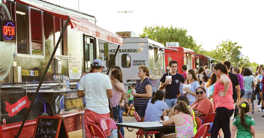 Customers wait in line to order their food Thursday afternoon during the Food Truck Festival & Movie Night at Father McNaboe Park. Photo: Victor Strife/Laredo Morning Times