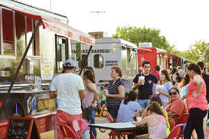 Customers wait in line to order their food Thursday afternoon during the Food Truck Festival & Movie Night at Father McNaboe Park.