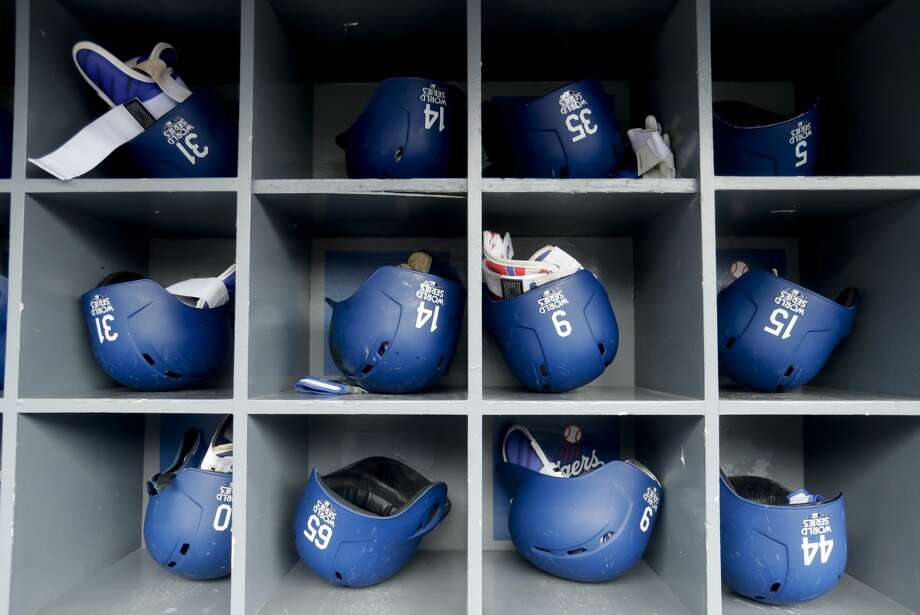 Los Angeles Dodgers batting helmets sit in the dugout before Game 6 of baseball's World Series against the Houston Astros Tuesday, Oct. 31, 2017, in Los Angeles. (AP Photo/Alex Gallardo) Photo: Alex Gallardo/AP