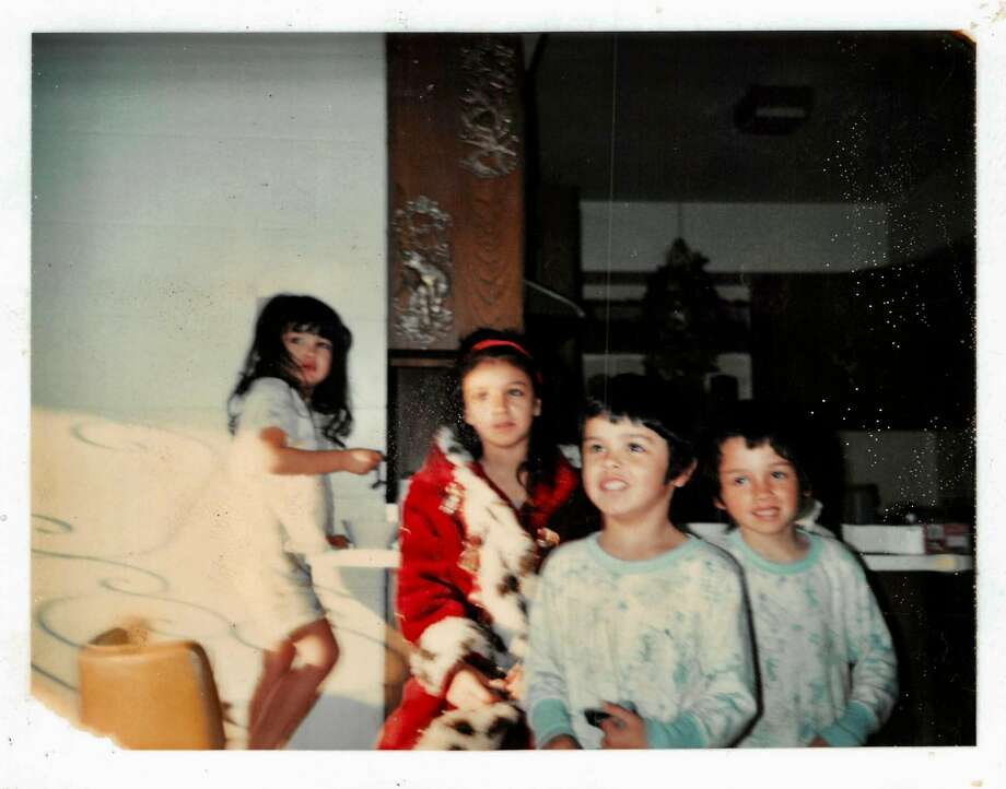 Joseph Ahearne (foreground) celebrates Christmas with his siblings as a child. Photo: Courtesy Ahearne Family