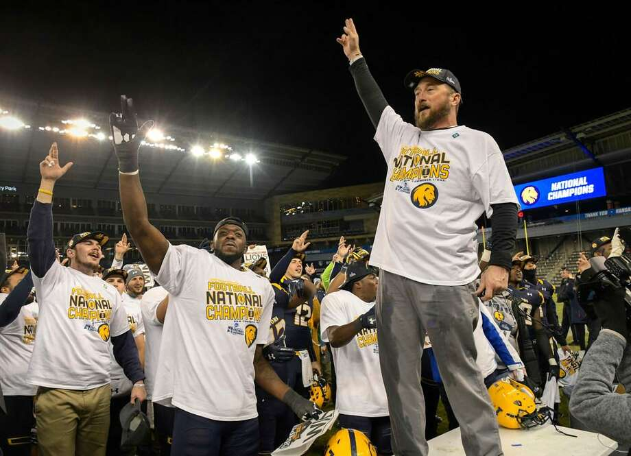 Texas A&M-Commerce head coach Colby Carthel celebrates with his team after winning the NCAA Division II college football championship game in Kansas City, Kan., Saturday, Dec. 16, 2017. Photo: Reed Hoffmann /AP Photo