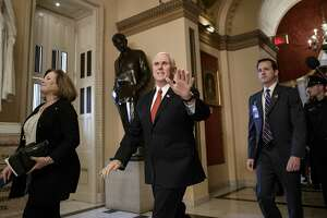 Vice President Mike Pence walks through the Capitol to the House Chamber to watch the passage of the Republican tax bill, in Washington, Tuesday, Dec. 19, 2017. (AP Photo/J. Scott Applewhite)