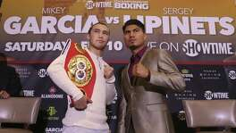 Mikey Garcia, of California, right, and unbeaten three-division world champion Sergey Lipinets, of Russia, poses for the media during a press conference, Tuesday, Dec. 19, 2017. They are the Showtime Championship Boxing main event fight at the Alamodome on February 10.