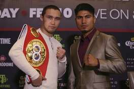Mikey Garcia, of California, right, and unbeaten three-division world champion Sergey Lipinets, of Russia, poses for the media during a press conference in December. The main event fight at the Alamodome on Feb. 10 between the two boxers has been postponed.