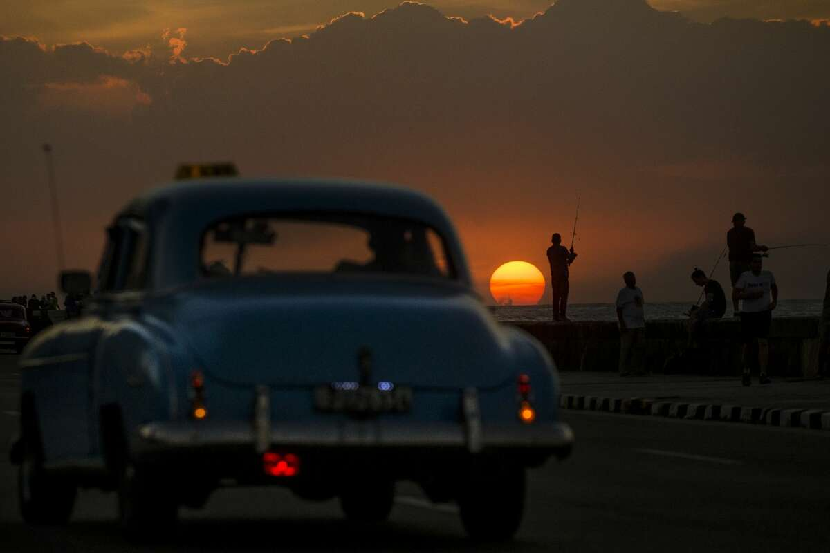 Fishermen cast their lines into the Bahía de la Habana from El Malecon at sunset Monday, Jan. 16, 2017 in Havana. While traveling to Cuba for tourism is still forbidden by the United States government, the easing of restrictions, direct flights and cruise services have made traveling to the island as an American a real possibility.