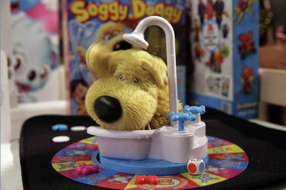 This Tuesday, Sept. 26, 2017, photo shows the Soggy Doggy game from Ideal on display at the 2017 TTPM Holiday Showcase in New York. Soggy Doggy, by toymaker Spin Master, features a plastic dog in a bathtub that shakes water on players. Photo: Richard Drew /Associated Press / AP