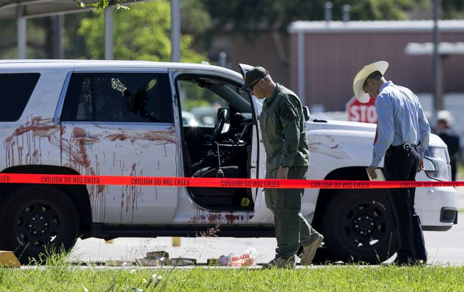 Authorities investigate the scene where Precinct 3 Assistant Chief Deputy Clint Greenwood was fatally shot behind the Baytown Courthouse Monday, April 3, 2017, in Houston. Photo: Godofredo A. Vasquez/Houston Chronicle