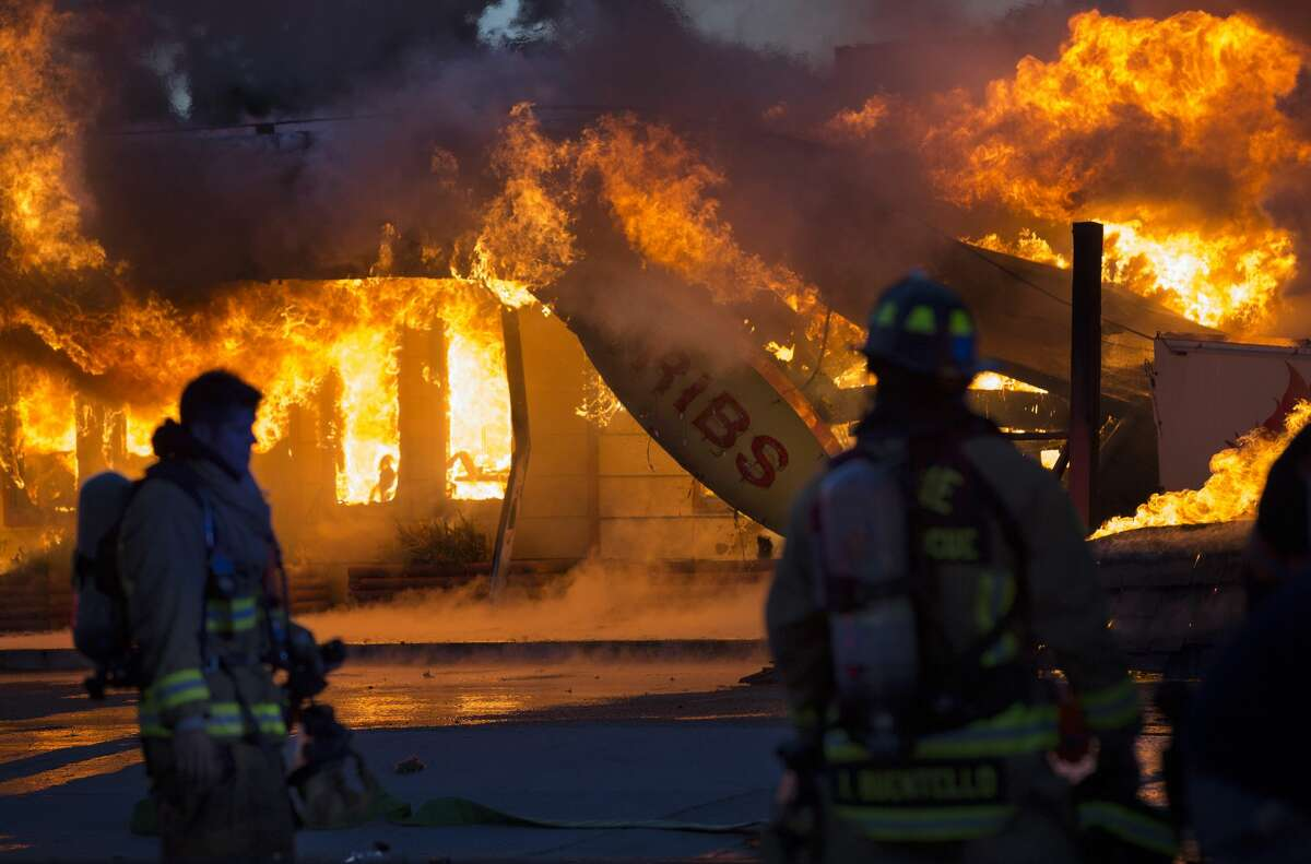 Local firefighters battle a fire that consumed Charlie's Bar-B-Q on Airline Drive Thursday, May 4, 2017, in Houston.