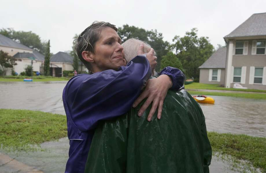 Amanda Ankney hugs her father, Byron Gilleon, after he was rescued from his home near Crossroads and Walkwood drives during Harvey. Photo: Godofredo A. Vasquez/Houston Chronicle