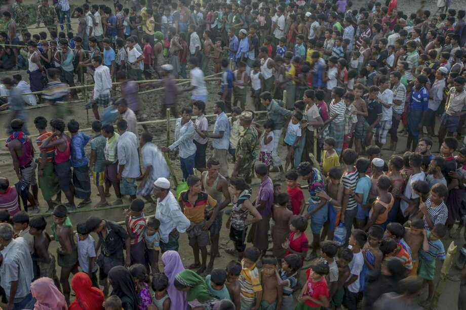 Rohingya Muslims, who crossed over from Myanmar into Bangladesh, wait to receive aid during its distribution near Balukhali refugee camp in Bangladesh in September. International aid group Doctors Without Borders said Dec. 14 that its field survey has found at least 6,700 Rohingya Muslims were killed between August and September in a crackdown by Myanmar's security forces. Photo: Dar Yasin /Associated Press / Copyright 2017 The Associated Press. All rights reserved.