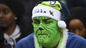 SEATTLE, WA - DECEMBER 17:  A Seahawks fan in Grinch makeup watches the game during the third quarter against the Los Angeles Rams at CenturyLink Field on December 17, 2017 in Seattle, Washington.  (Photo by Steve Dykes/Getty Images)