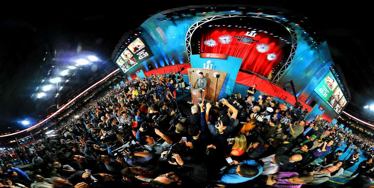 Tom Brady is surrounded by the media during Super Bowl Opening Night at Minute Maid Park, Monday, Jan. 30, 2017, in Houston. This image was made with a 360 degree panoramic camera.