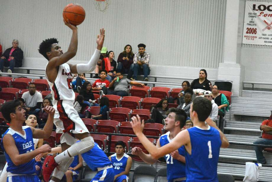 Lockney's Jaden Rosales soars to the basket for two of his 34 points against Plainview Christian Academy Monday night. Photo: Skip Leon/Plainview Herald