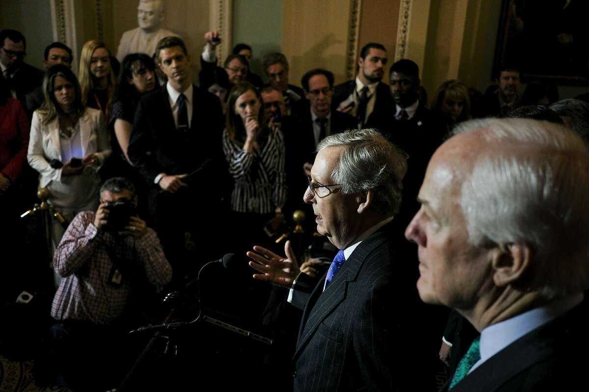 Senate Majority Leader Mitch McConnell (R-Ky.) at a news conference with other Republican leaders about the Republican tax plan on Capitol Hill in Washington, Dec. 19, 2017. The House on Tuesday approved the most sweeping tax overhaul in decades, voting along party lines to enact deep and permanent tax cuts for corporations and temporary cuts for individuals. (Gabriella Demczuk/The New York Times)
