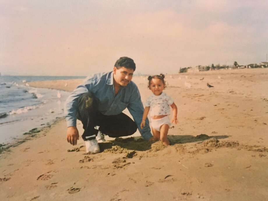 Eusebio Sanchez and his daughter Vianney, 2, at the beach in Alameda in 1996. Photo: Handout, Courtesy The Mendoza-Sanchez Family