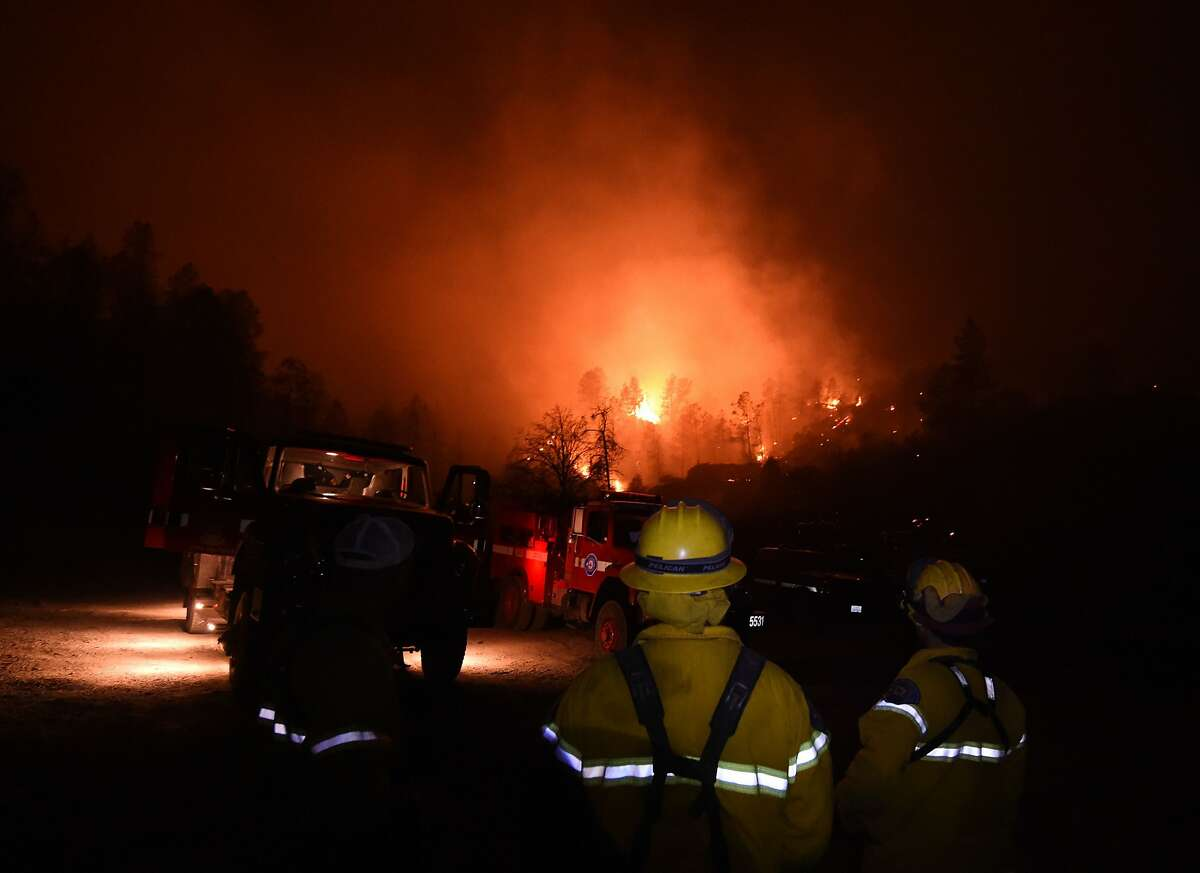 Firefighters keep watch as the Valley Fire flares up in Middletown, California on September 15, 2015.