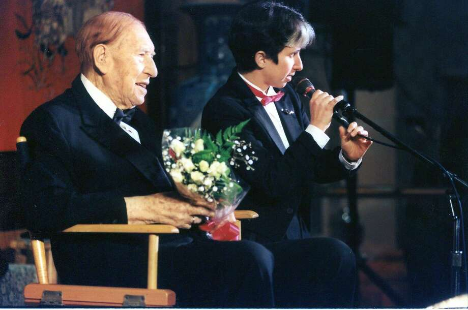 Lisa Geduldig introduces Henny Youngman at the fifth annual Kung Pao Kosher Comedy show in 1997, for what turned out to be the comedy great's last performance. Photo: Photo Credit: Katy Raddatz