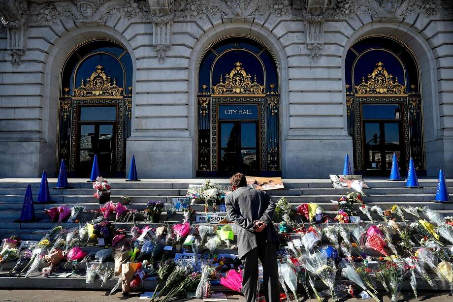 People stop to observe the memorial to Mayor Ed Lee in front of City Hall, as seen on Thursday December 14, 2017, in San Francisco, Calif. Photo: Michael Macor, The Chronicle